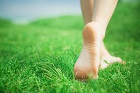 barefoot walking in grass
